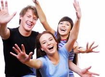 Adolescentes felices con las pistas levantadas Imagen de archivo libre de regalías