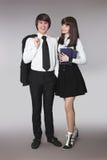 Adolescentes felices que se divierten en retrato del uniforme escolar hermoso Imágenes de archivo libres de regalías