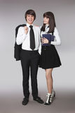 Adolescentes felices que se divierten en retrato del uniforme escolar hermoso Imagen de archivo libre de regalías