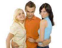 Adolescentes - homem e duas mulheres Fotos de Stock Royalty Free