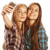 Adolescentes lindos que hacen el selfie aislado Imágenes de archivo libres de regalías