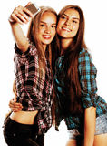 Adolescentes lindos que hacen el selfie aislado Foto de archivo