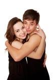 Adolescentes menino e menina no amor que abraça e que ri. Imagens de Stock Royalty Free