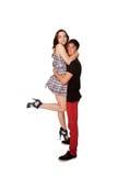 Adolescentes muchacho y muchacha en el abrazo del amor fotos de archivo libres de regalías