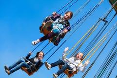 Adolescentes no carrossel do balanço Imagens de Stock Royalty Free