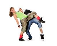 Adolescentes que bailan breakdance en la acción Imágenes de archivo libres de regalías