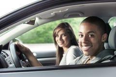 Adolescentes que conducen el coche Fotografía de archivo libre de regalías