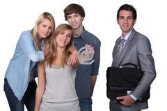 Adolescentes que llevan a cabo @ la muestra Fotos de archivo