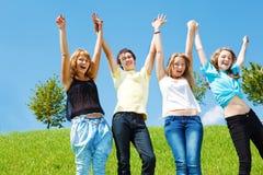 Adolescentes que llevan a cabo las manos Fotografía de archivo libre de regalías