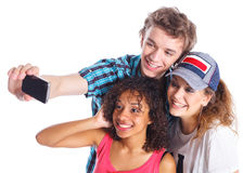 Adolescentes que toman una foto del uno mismo Imagen de archivo libre de regalías