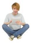 Adolescentes que usan la tablilla Fotografía de archivo libre de regalías