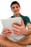 Adolescentes que usan la tablilla Fotos de archivo libres de regalías