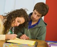 Adolescentes studing Foto de archivo