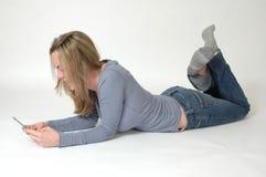 Adolescentes y teléfonos celulares Imagen de archivo