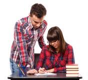 Adolescenti che fanno insieme compito Fotografia Stock