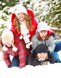 Adolescenti che giocano nella neve Fotografia Stock