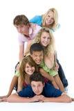 Adolescenti in cima ad uno un altro Immagini Stock Libere da Diritti