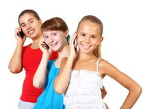 Adolescenti graziosi con il telefono cellulare Immagini Stock