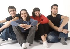 Adolescents. Portrait of four adolescents on white background Stock Photography