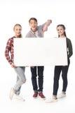 Adolescents avec la bannière vide d'isolement sur le blanc Image stock