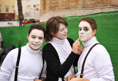 Adolescents in Carnaval of Cadiz, Andalusia, Spain. Girl painting the face of a boy dressed as a mime during the Carnival of Cadiz in Spain stock photo