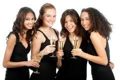 Adolescents divers avec des verres à vin Photographie stock