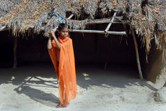 Adolescents in India. February 12, 2011.West Bengal,India,Asia-A adolescent girl standing in front of a hut in a village Stock Photos