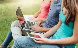 Adolescents at the park reading and connecting Royalty Free Stock Photo