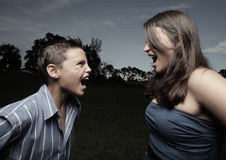 Adolescents screaming at each other. Two young people screaming at each other Royalty Free Stock Images