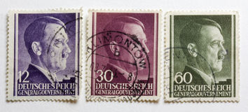 Adolf Hitler portrait on three German World War II. Post stamps issued and postmarked on the territory of occupied Poland (the General Government Royalty Free Stock Images