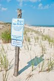 Adopt a beach sign Stock Images