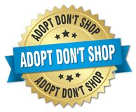 Adopt don`t shop 3d gold badge. With blue ribbon Royalty Free Stock Photos