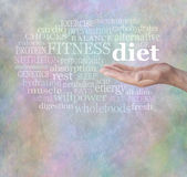 Adopt a Healthy Diet. Male hand facing palm up surrounded by a softly glowing word cloud relative to diet, on a light multicolored stone effect background royalty free stock images
