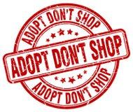 Adopt mettent le tampon en caoutchouc rond grunge rouge de vintage de boutique du ` t Images stock