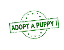 Adopt a puppy. Rubber stamp with text adopt a puppy inside,  illustration Stock Images