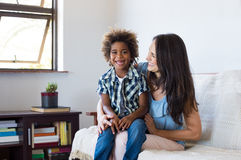 Adopted child playing with mother Stock Image