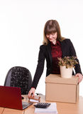 Adopted at work in office girl puts things out of box Stock Photography