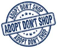 adoptez mettent le timbre rond grunge bleu de vintage de boutique du ` t Photographie stock
