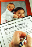 Adoption. Certificate and potography of children Royalty Free Stock Image