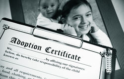 Adoption. Certificate and potography of children Royalty Free Stock Photography