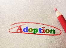 Adoption circled in red. Colorful adoption text circled in red pencil Royalty Free Stock Images