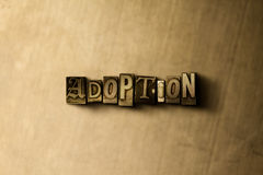 ADOPTION - close-up of grungy vintage typeset word on metal backdrop Royalty Free Stock Photography