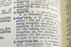 Adoption concept. Closeup of adoption definition in colorful letters Royalty Free Stock Image