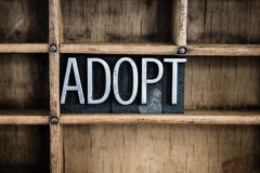 Adoption Concept Metal Letterpress Word in Drawer Stock Photos