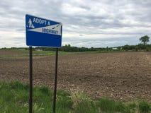 Adoptuje autostrada znaka fotografia royalty free