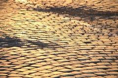 Adoquines en la puesta del sol Foto de archivo libre de regalías