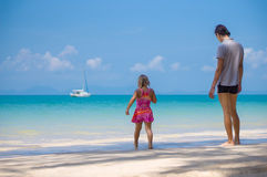 Adorabel daughter and father on sand beach of ocean Stock Photography
