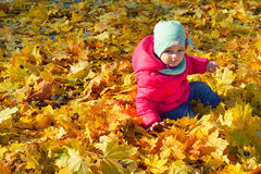 Adorabl little baby girl relaxing in the autumn park Royalty Free Stock Photography