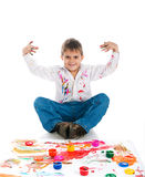 Adorable 3 year old boy covered in paint Stock Photography