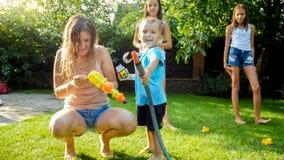 Free Adorable 3 Years Old Toddler Boy Splashing Water From Plastic Toy Gun At House Backyard. Children Playing And Having Fun Stock Photography - 148270342